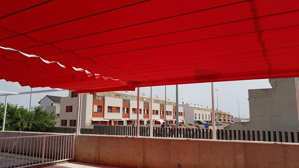 Toldos planos correderos en Colegios de Grao Castellón y Onda
